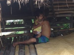 Sumbanese boy carrying baby girl